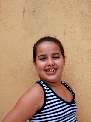 Letecia is ten years old. She loves to listen to music and to draw. When she grows up she wants to be an actress.