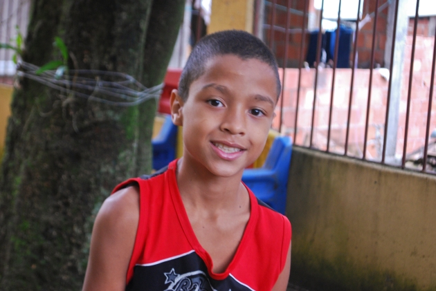 Leandro is eleven years old and has two sisters and three brothers. He likes to study portuguese and play soccer. He wants to be a lawyer when he grows up.
